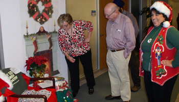 Lynn Tierney and President Yudof helped judge decorations.