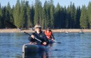 Two kayakers on Pinecrest Lake at Lair of the Golden Bear