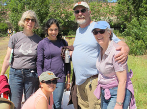 Judy Peck, Kay Coelho, Doug MacNeil, Tracy FitzGerald and Jeane Kim were among the UCOP volunteers who cleaned up Oakland's Channel Park.