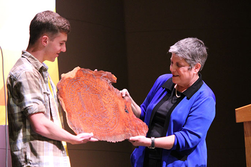 "Credit: Kate Breyer/Arcata High School One of a few dignitaries to make the visit ""behind the Redwood Curtain,"" Napolitano received a gift of burlwood engraved with the UC seal."