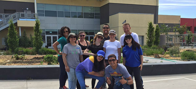 UCOP staff digs volunteering at Oakland school garden