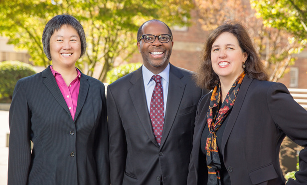 Left to right: Margaret Wu, managing counsel, Charles Robinson, general counsel vice president and Karen Petrulakis, chief deputy general counsel
