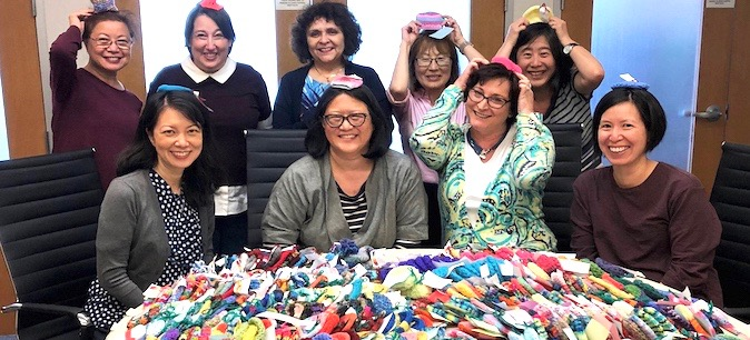 Hats off to UCOP knitters who made 950 caps for premature babies