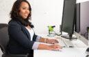 Young woman sitting at computer