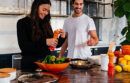 Couple cooking peppers in a red bowl