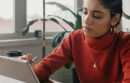 Woman working on digital notebook
