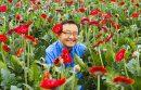 Man sitting in field of flowers