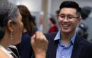 Tina Hinnant, left, chats with University of California graduate Joseph Chun at an alumni job fair at the South San Francisco Conference Center, Thursday, May 2, 2019 in South San Francisco, Calif. (Photo by D. Ross Cameron)