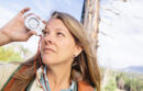 Woman looking through digital viewfinder