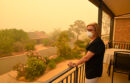 Woman standing in smoky air from wildfire