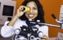 Ophthalmologist looking through eyesight tool