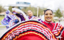 Women dancing in traditional Mexican dresses