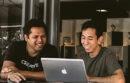 Men working at laptop computer